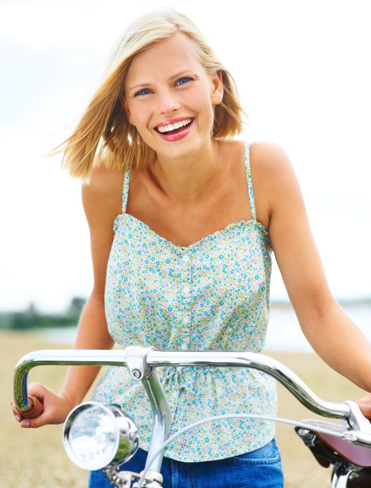 blonde girl riding a bicycle
