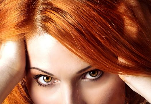 woman with red hair and amber eyes