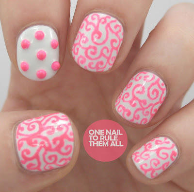 pink and white swirly painted nails