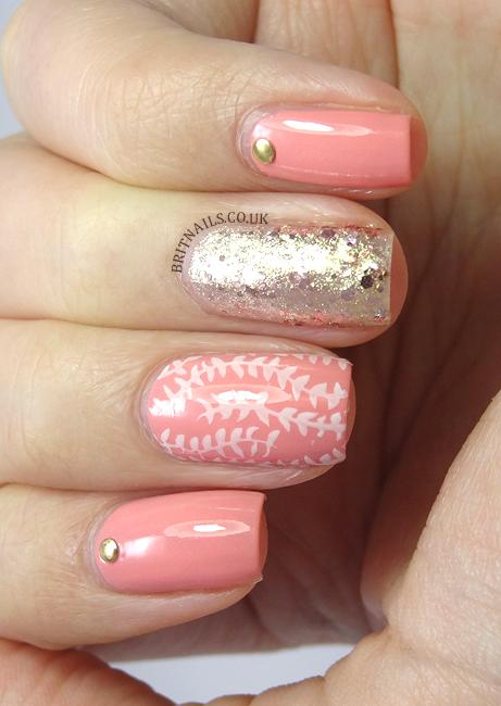 pink nail polish with white vine decor and gold