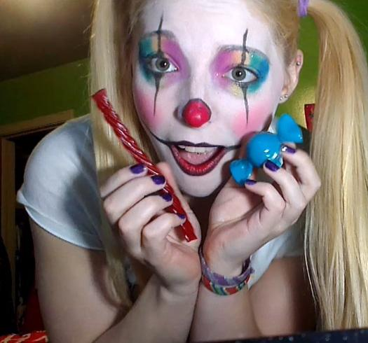 girl wearing rainbow clown makeup