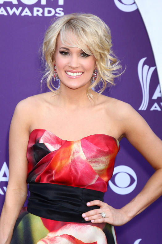 carrie underwood with mesy updo