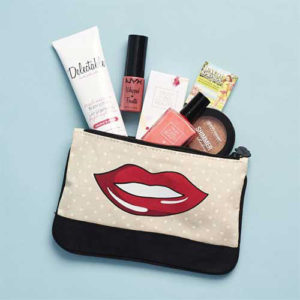 Ipsy beauty box bag with contents spilling out