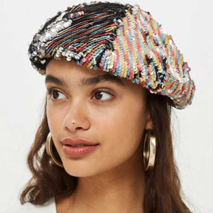Woman modeling a sequin beret