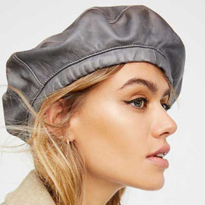 Woman modeling a leather beret