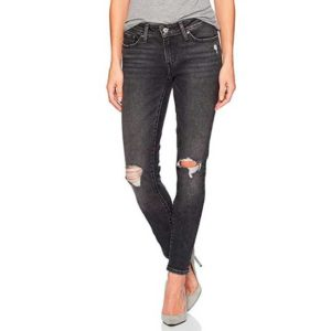 Woman wearing a pair of distressed faded black Levi's jeans