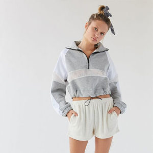 gray quarter zip hoodie with white knit shorts on model