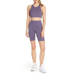 mauve sports bra and bike shorts separates on model
