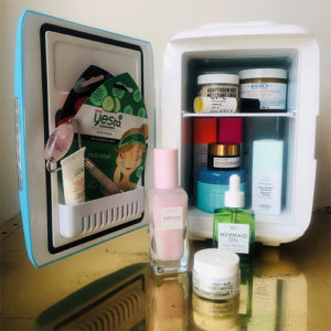 Cooluli mini fridge stocked with skincare products