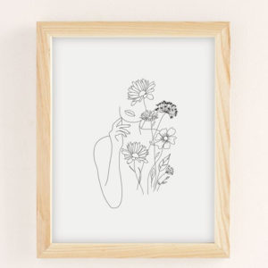Drawing of a woman and flowers wall art