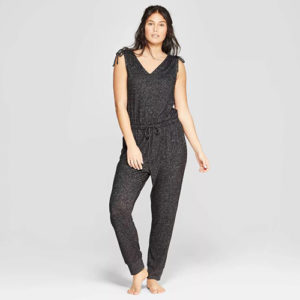 Woman wearing a grey speckled pj jumpsuit