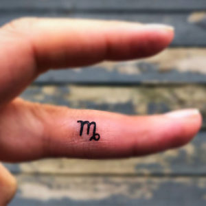 Virgo side of finger temporary tattoo