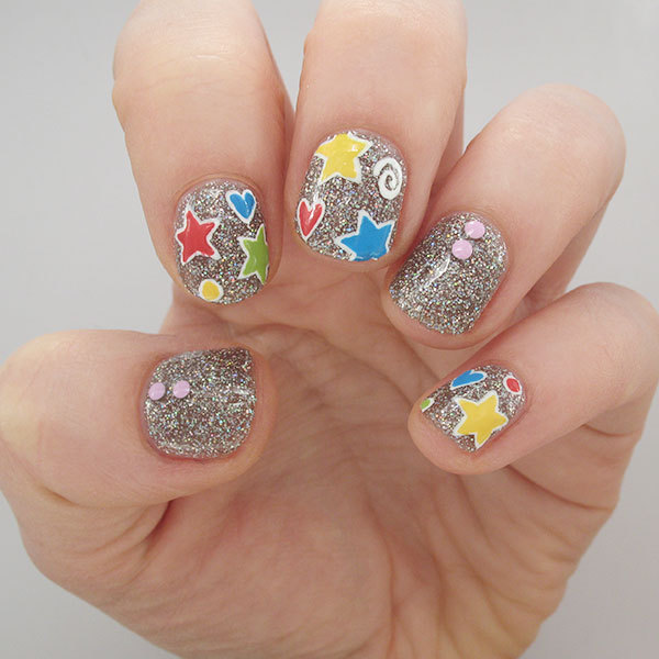 Playful Patterned & Glitter Nail Design