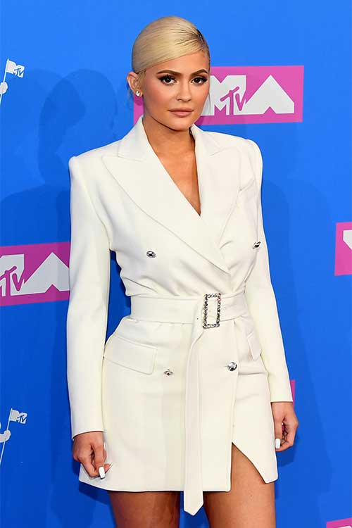 Kylie Jenner wearing a white trench dress at 2018 MTV VMAs