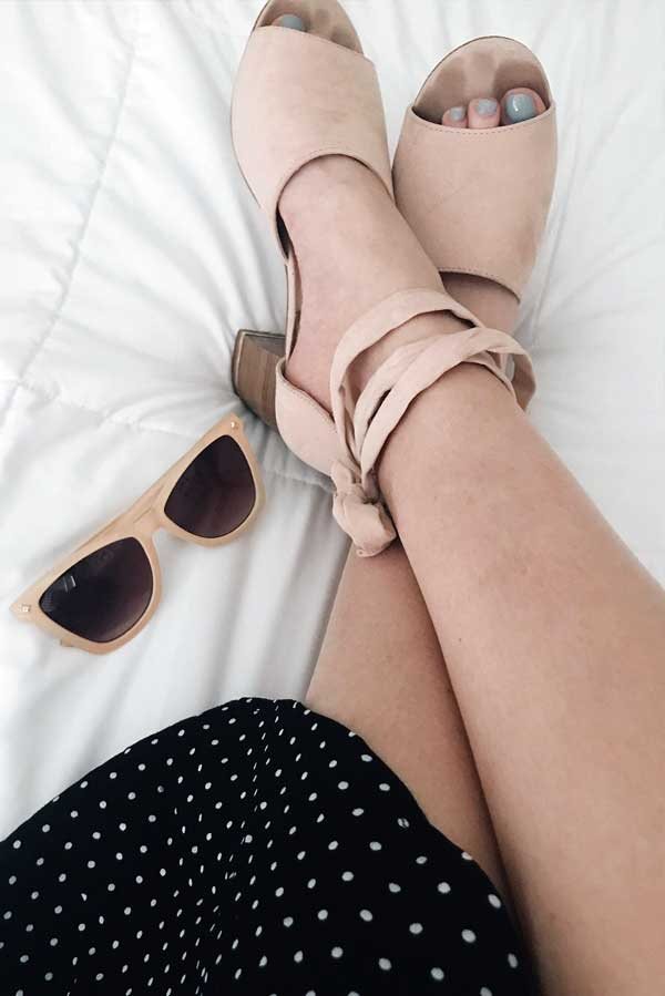 wrap-around open-toed pink heels, retro sunglasses, and polka dot skirt