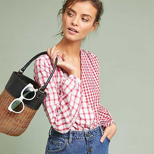 model wearing red plaid print body suit and denim skirt with straw bag