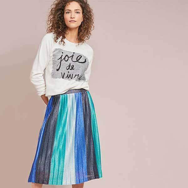 model wearing blue and green striped metallic pleated skirt
