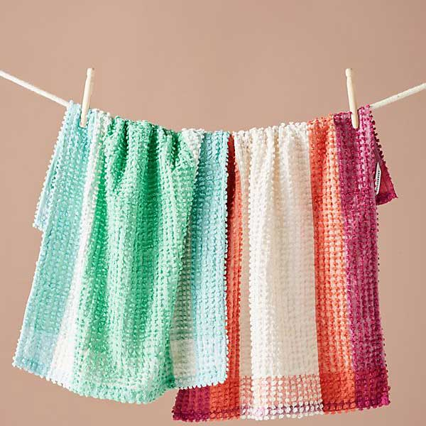 striped and textured dish towels on clothes line