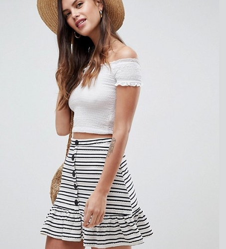 black and white horizontal striped skirt with black buttons down the front and ruffle hem