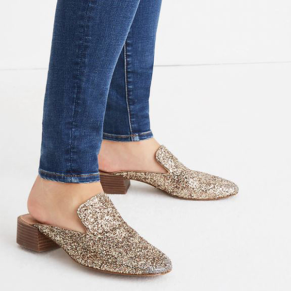 Model wearing jeans and gold glitter mules