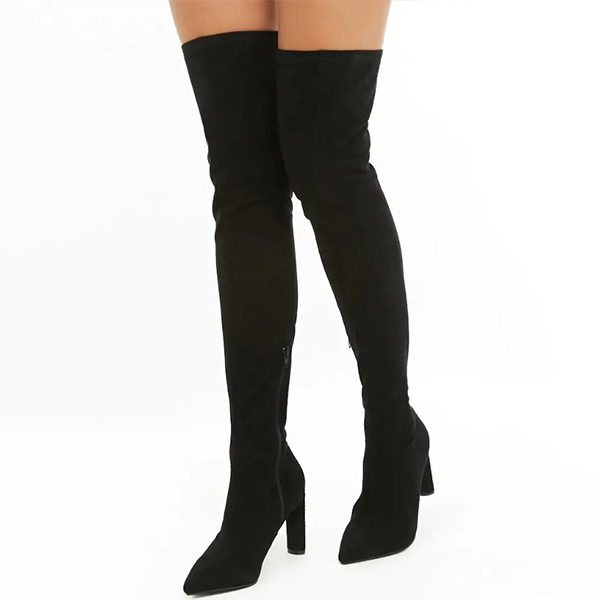 Model wearing black thigh high boots