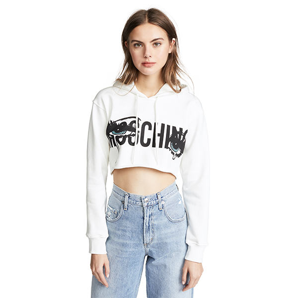 Model wearing a Moschino Crying Eyes cropped hoodie