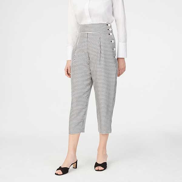 Black and white patterned, cropped pants with side button details.