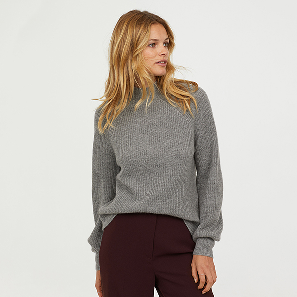 Model wearing a grey cashmere sweater