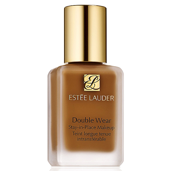 Estee Lauder foundation in a clear glass far with gold lid