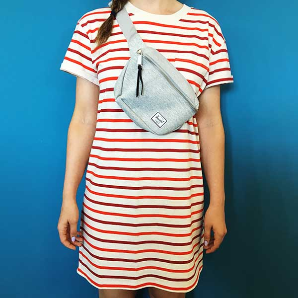 Wearing fanny pack across chest with striped dress