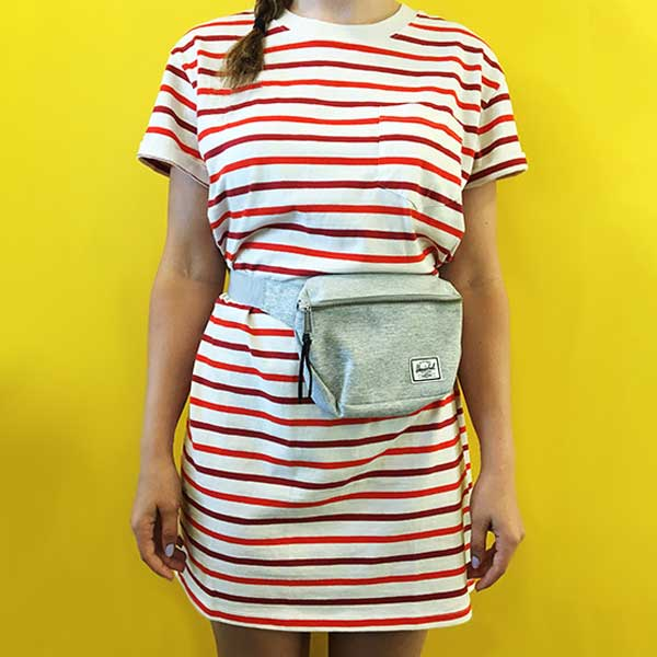 wearing fanny pack across waist with a striped dress