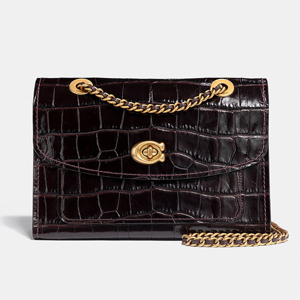 Plum crocodile-embossed Coach crossbody bag