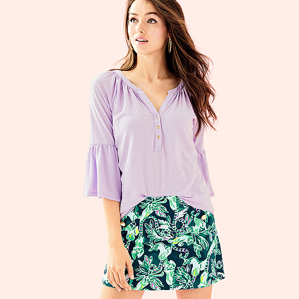 Purple flowing blouse over a green tropical Lilly Pulitzer printed skort