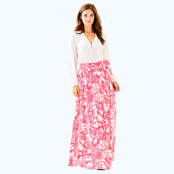 Model wearing a white blouse and a pink and white, floral printed maxi skirt