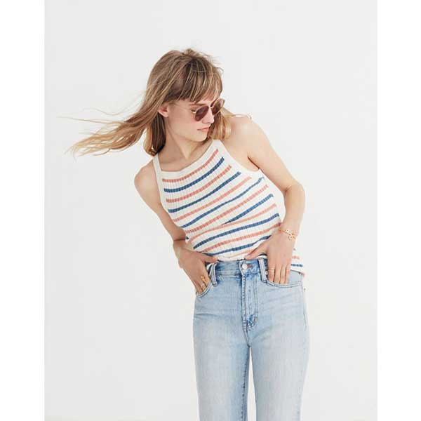 woman wearing a striped tank top and jeans