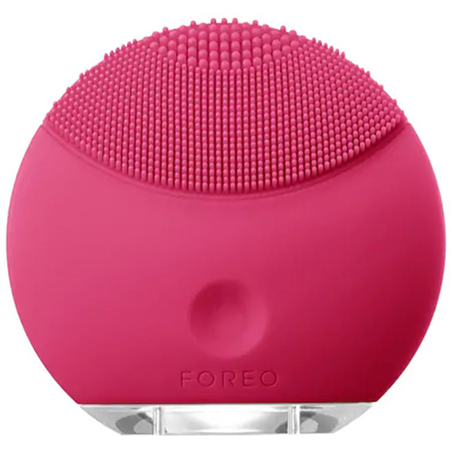 Pink textured cleansing brush