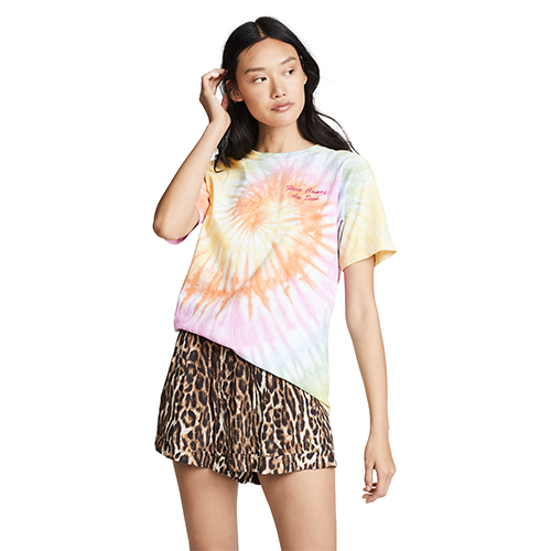 Woman wearing a tie-dye t-shirt with leopard print shorts