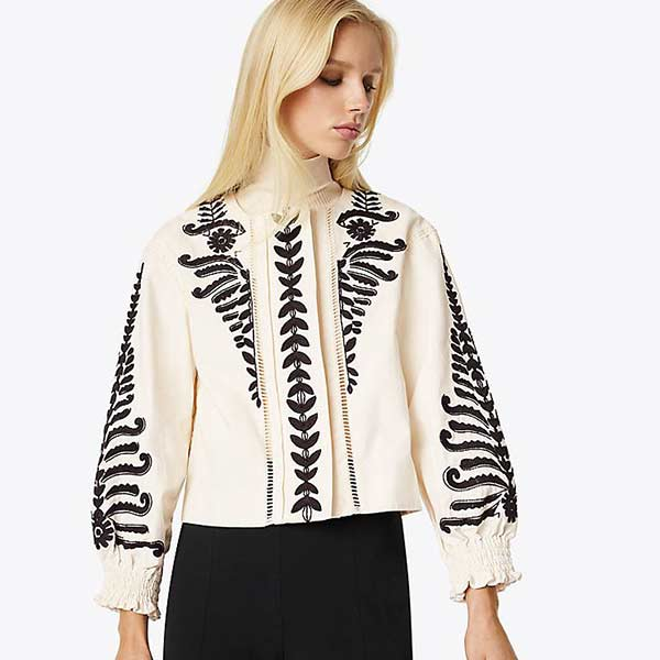 White jacket with black embroidery.