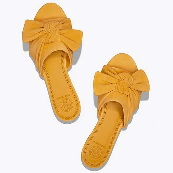 Yellow bow tied slides.