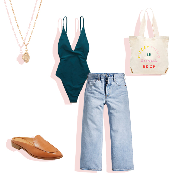 Teal one-piece swimsuit, crop flare jeans, gold locket necklace, graphic tote, and tan backless slides flat lay.
