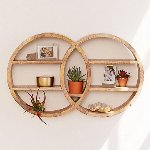 Two round wooden wall shelves